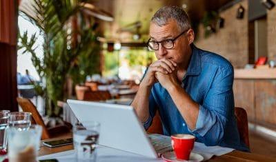 Man using computer at coffee shop